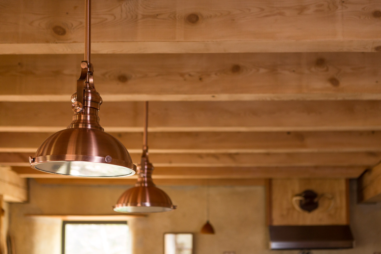 Copper lighting detail photo of kitchen renovation for New Frameworks Natural Building