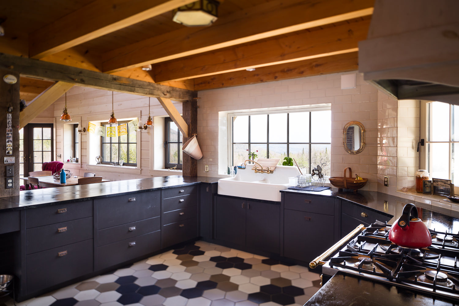 Interior architecture photo of kitchen in efficient farmhouse built by New Frameworks Natural Building in Middlesex Vermont