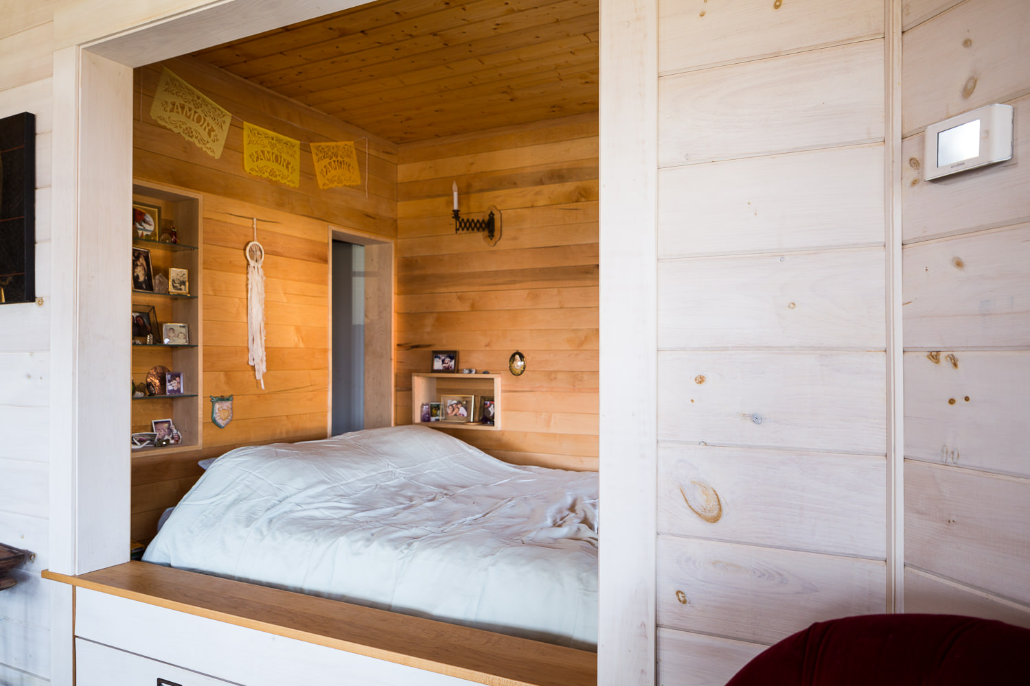 Interior architecture photo of bedroom in efficient farmhouse built by New Frameworks Natural Building in Middlesex Vermont