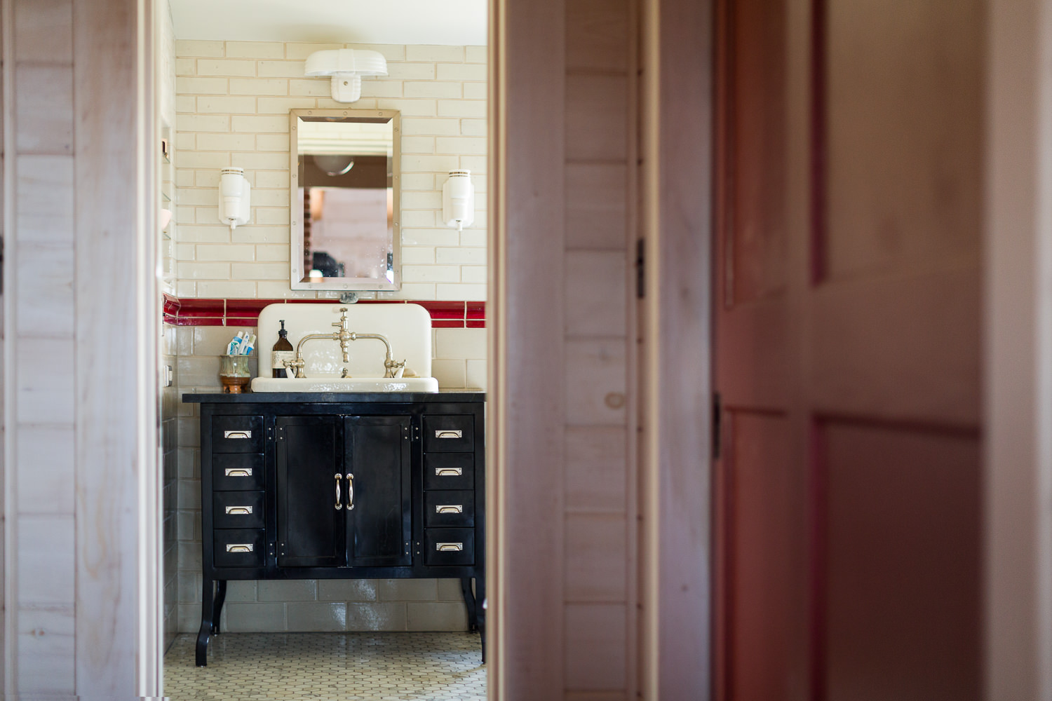 Interior architecture photo of bathroom in efficient farmhouse built by New Frameworks Natural Building in Middlesex Vermont