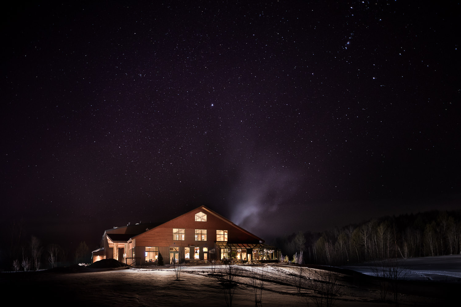 Exterior photo shot at twilight of the von Trapp Brewery Bierhall in Stowe Vermont by Vermont architecture photography Studio SB